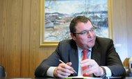 Levnější euro bude v polovině příštího roku, slibuje Singer