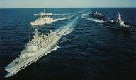 Ministr obrany: Lodě NATO budou vracet migranty zpátky do Turecka