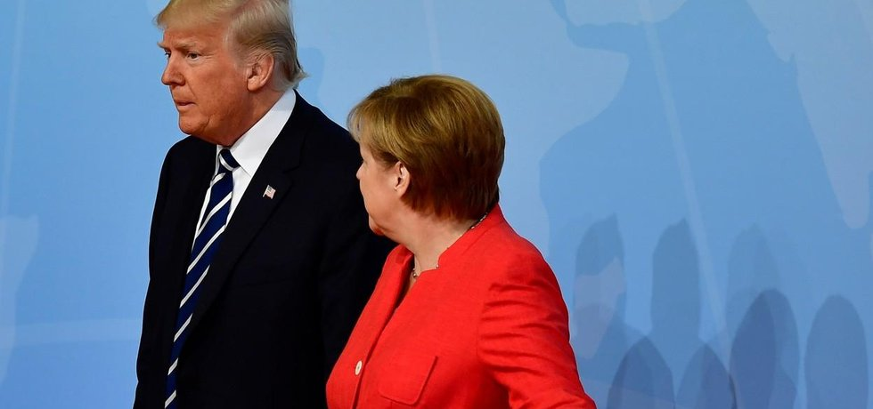 Donald Trump a Angela Merkelová na summitu G20