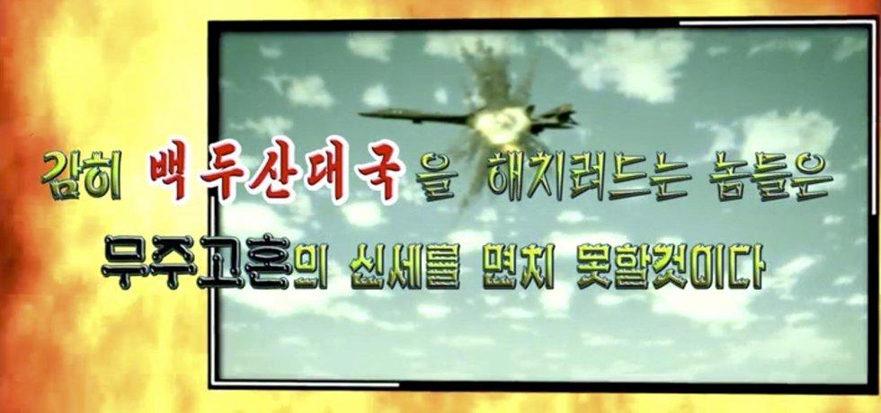 Snímek ze severokorejského propagandistického videa s  motivem explodujícího amerického bombardéru B-52
