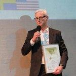 Jan Blažíček přebírá ocenění a titul národního vítěze Quality Innovation Award.