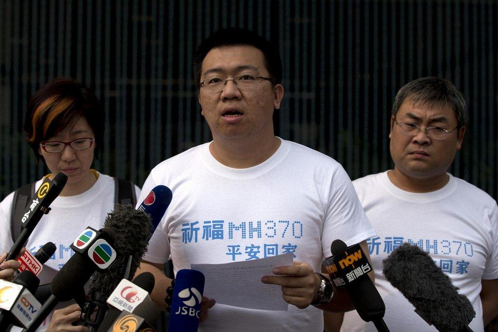 Zástupci příbuzných čínských obětí ze zmizelého Boeingu Malaysia Airlines